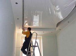 ceiling contractor working in house