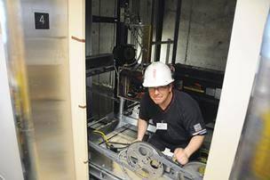 elevator installer working on tower in toronto